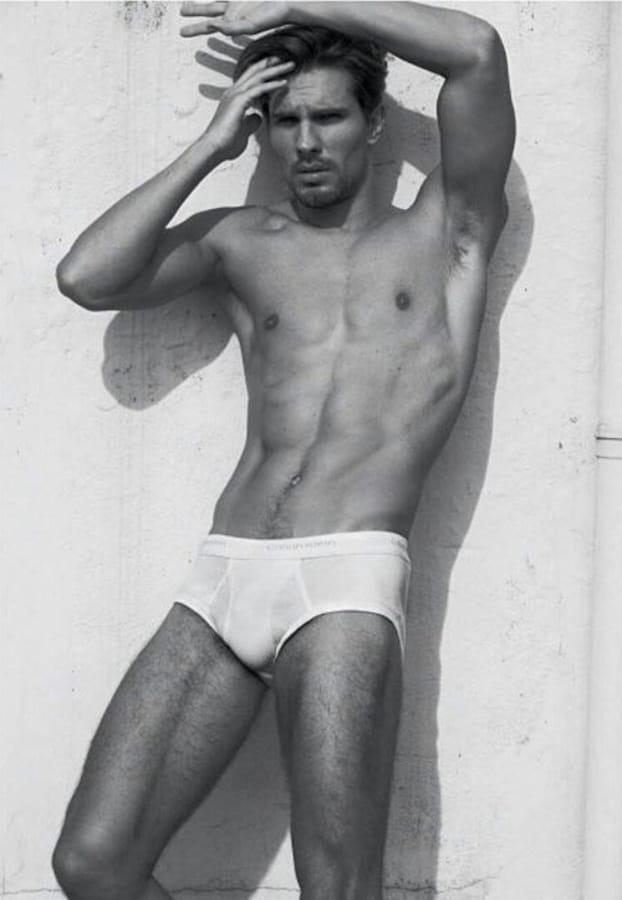 Balistarz-model-Tobi-Klanner-black-and-white-full-body-shot-wearing-under-wear-leaning-against-the-wall