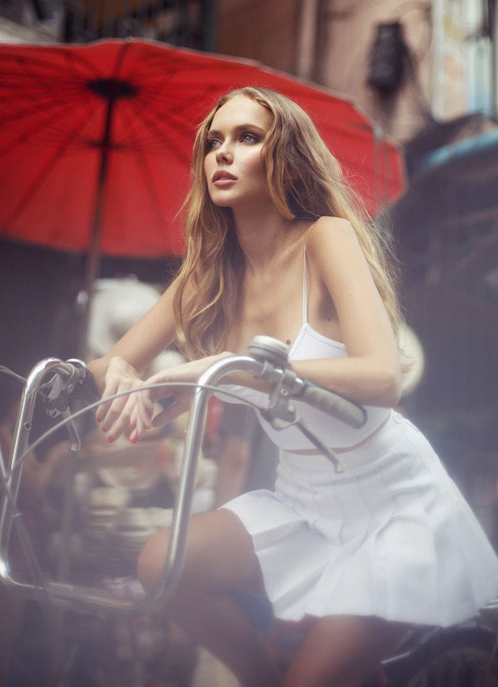 Balistarz-model-Angelina-Boyko-portrait-shoot-riding-a-bicycle-in-a-white-skirt-for-Playboy