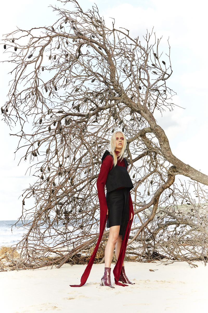 Balistarz-model-Brodie-Halford-outdoor-fashion-at-the-beach-in-elegant-black-dress-and-red-scarf