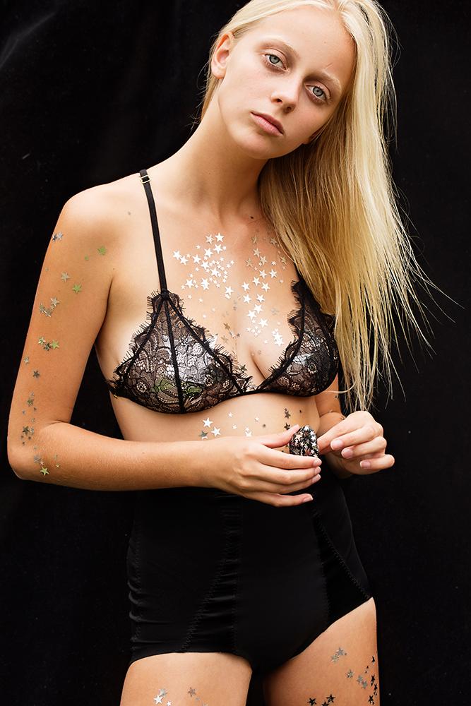 Balistarz-model-Brodie-Halford-studio-session-black-background-model-wearing-mini-dress