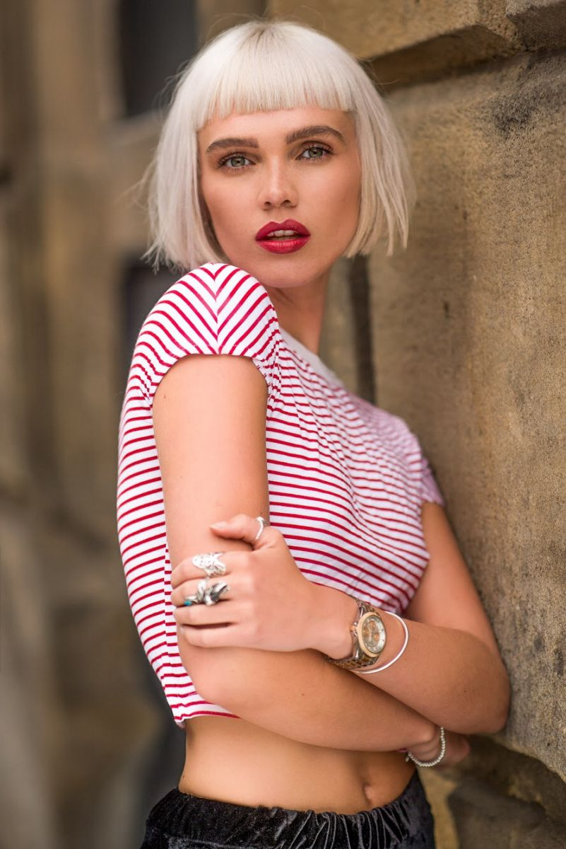 Balistarz-model-Chloe-Bell-portrait-shoot-in-a-candy-cane-color-schemed-shirt-with-rings