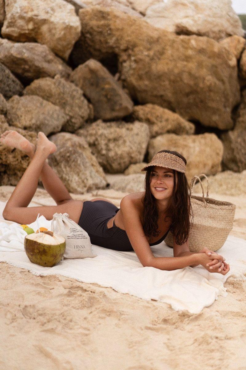 Balistarz-model-Diana-Mihaila-portrait-beach-shoot-in-a-black-swimsuit-laying-on-a-towel