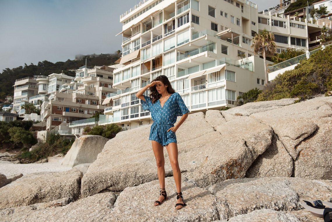 Balistarz-model-Eileen-Cassidy-blue-dress-lookout-on-rocks-in-beautiful-setting