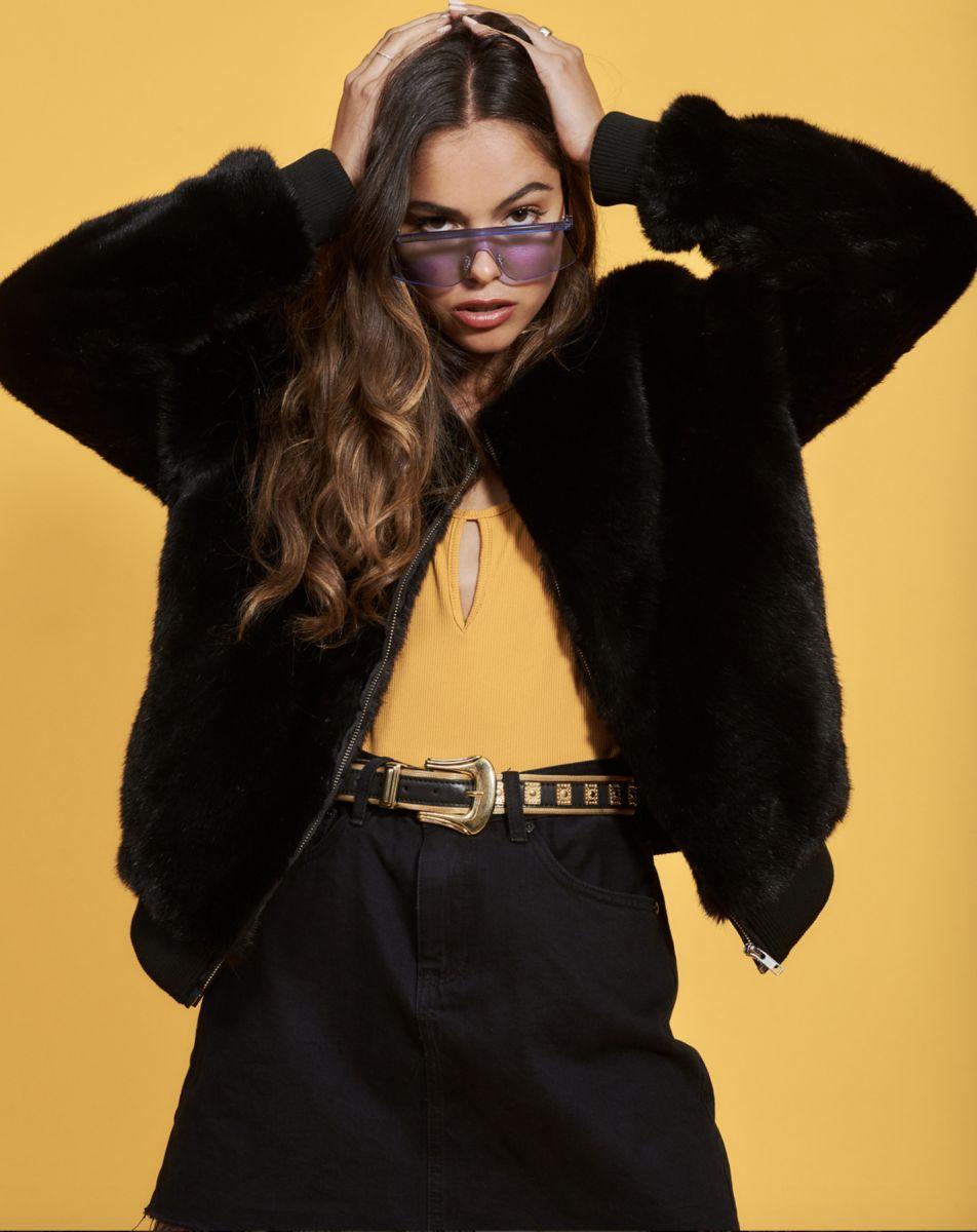 Balistarz-model-Elissa-Burns-shot-for-casual-and-elegant-black-outfit-in-yellow-background-indoor-studio-2