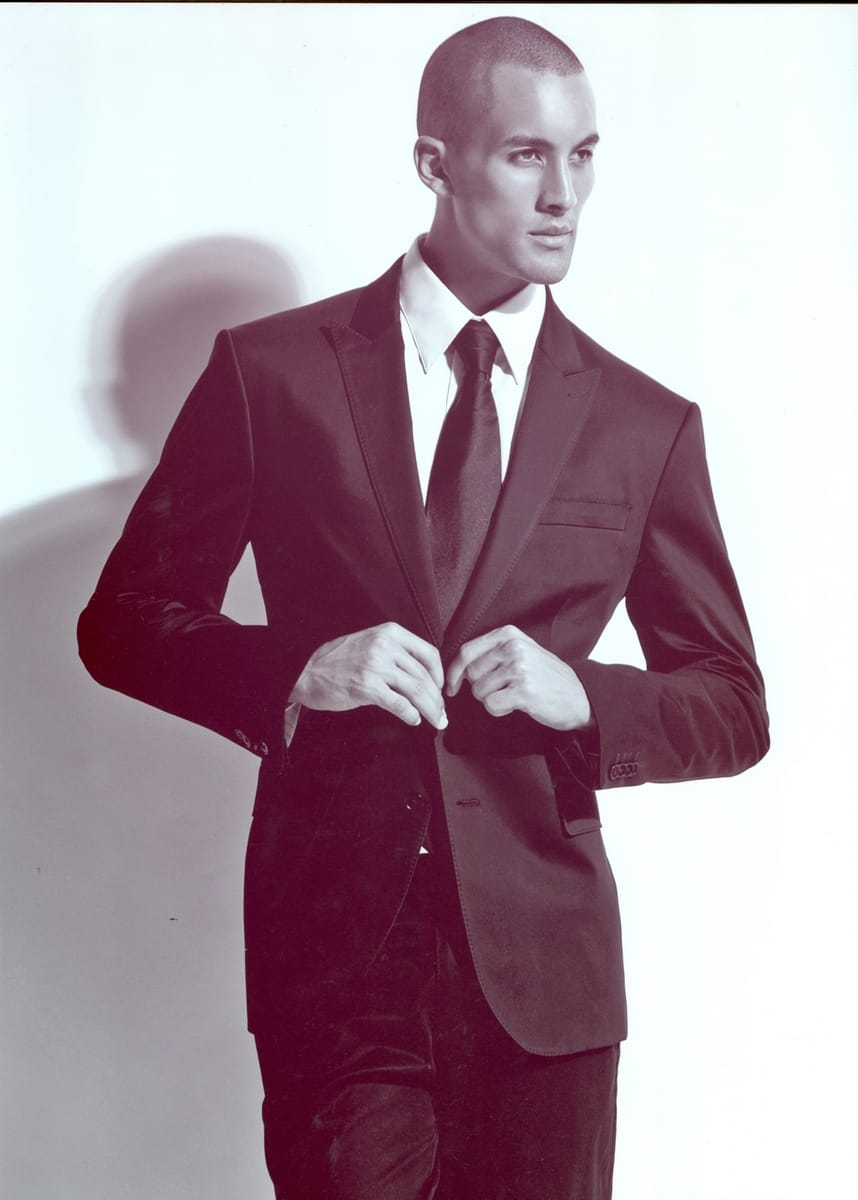 Balistarz-model-emile-steenveld-portrait-image-wearing-formal-dress-image-in-duo-tone-color-style