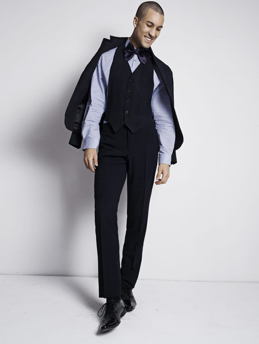 Balistarz-model-Emile-Steenveld-standing-in-front-of-clean-wall-in-formal-party-dress