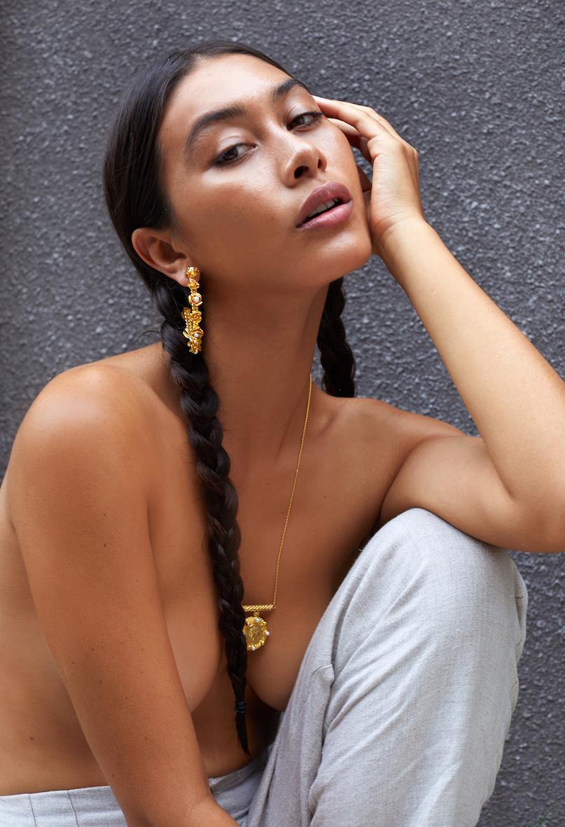 Balistarz-model-portrait-shoot-with-golden-accessories-with-white-sweatpants
