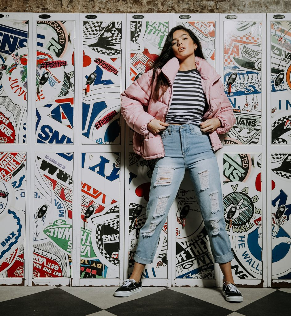 Balistarz-model-Fifi-Anicah-portrait-shoot-with-graffitis-on-the-lockers-in-a-pink-jacket-and-ripped-jeans