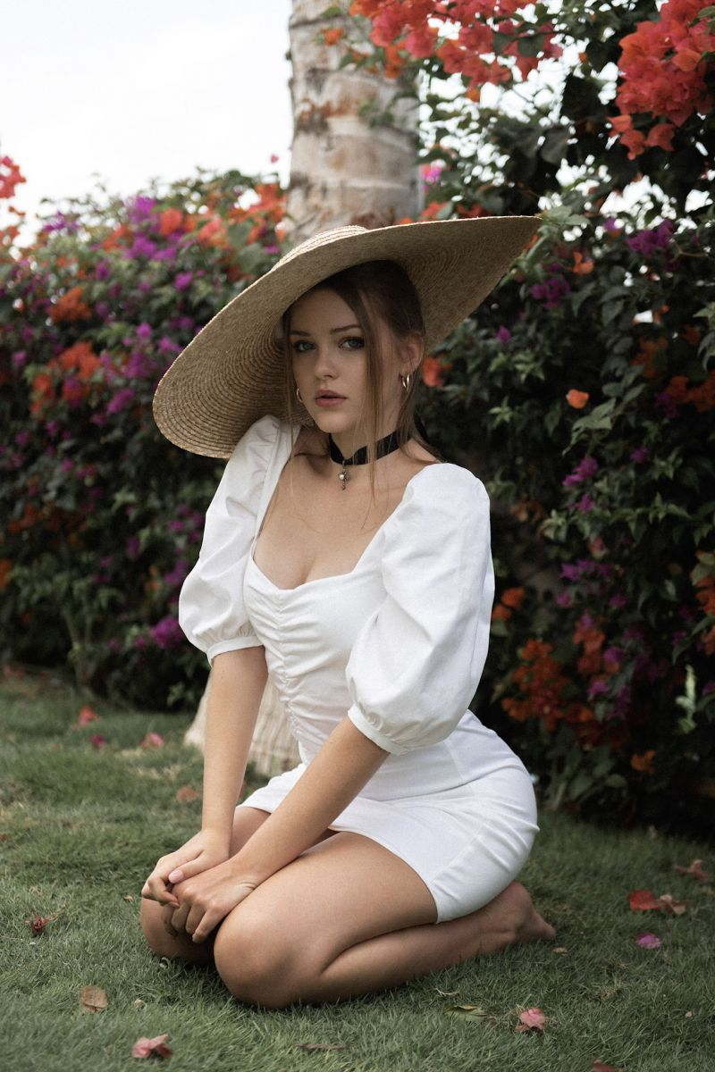 Balistarz-model-India-Rose-portrait-shoot-in-elegant-clothing-sitting-on-the-grass-with-beautiful-flowers