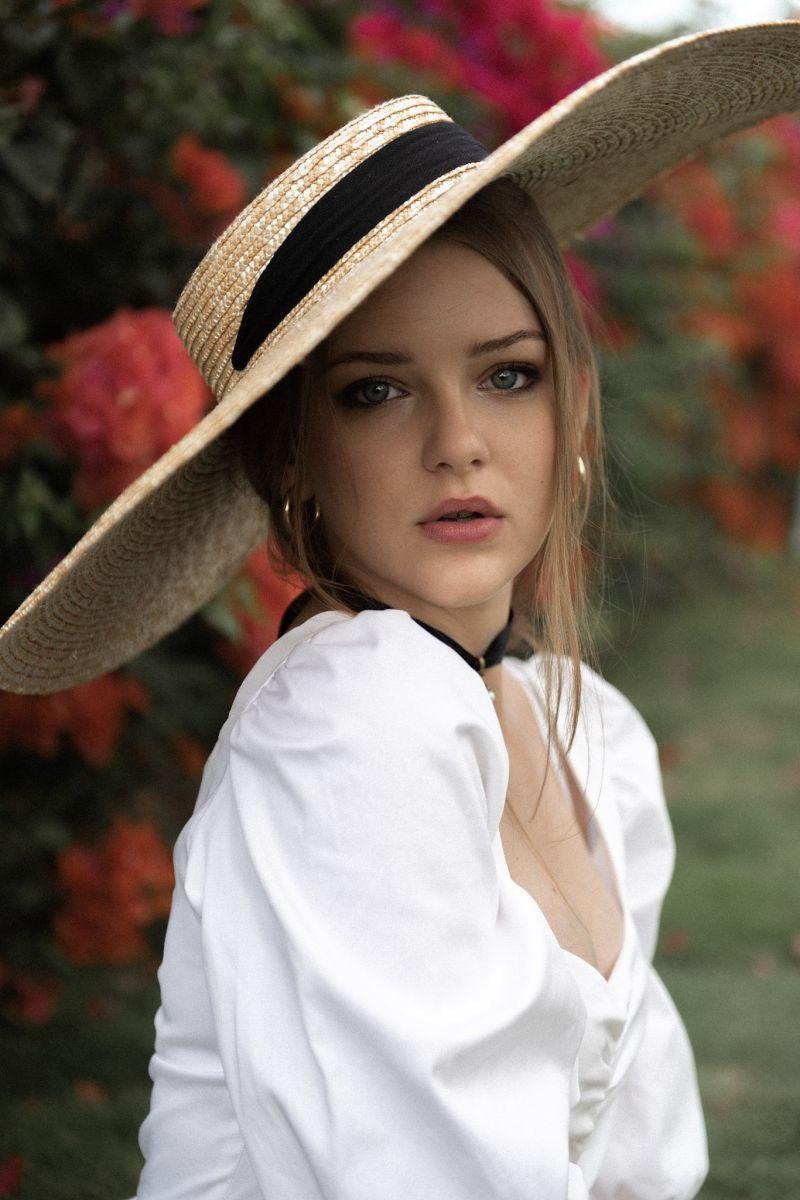 Balistarz-model-India-Rose-portrait-shoot-in-fancy-clothing-with-a-hat-relaxing-in-a-beautiful-garden