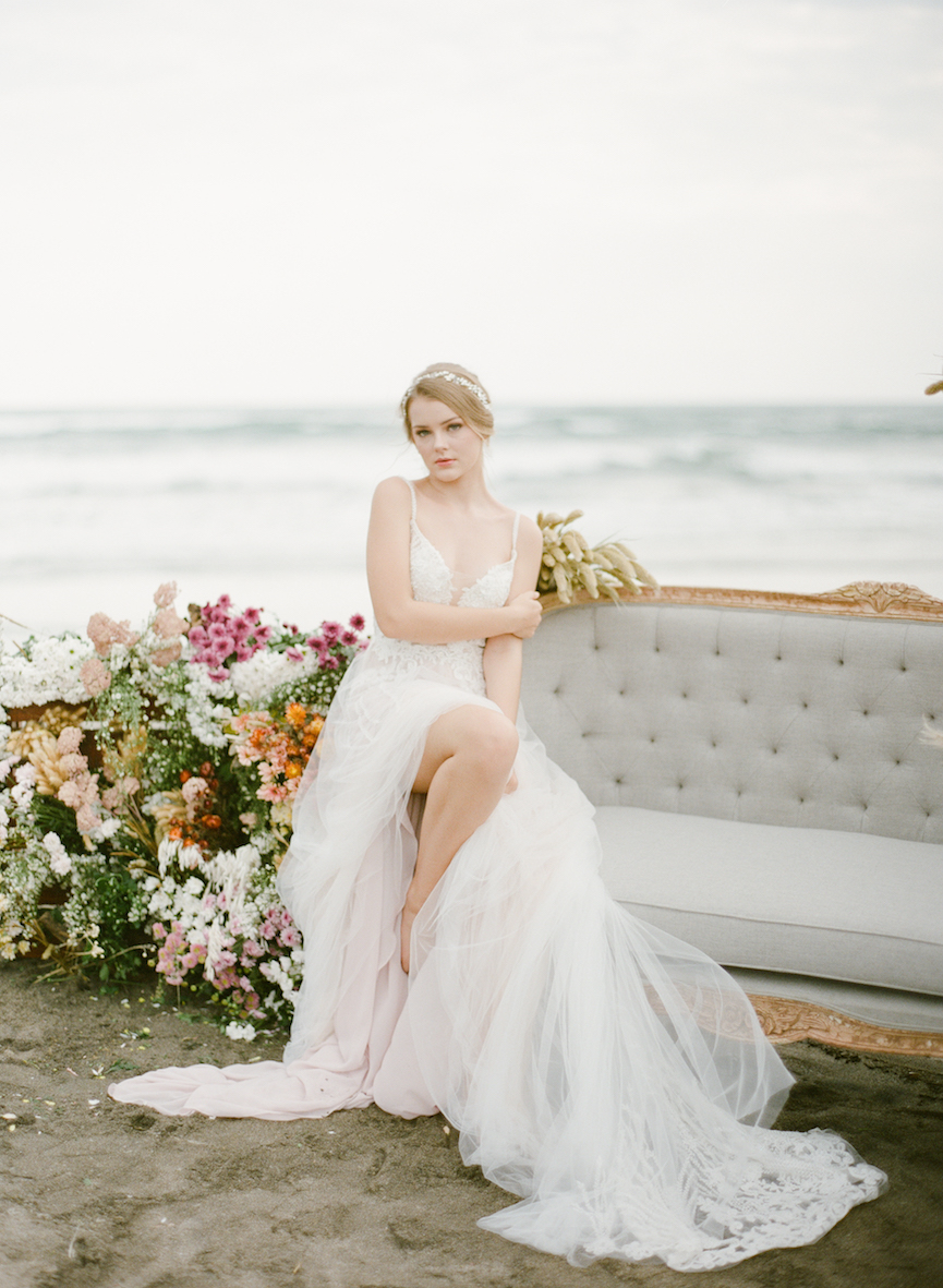 Balistarz-model-India-Rose-portrait-shoot-in-a-beautiful-white-dress-sitting-on-a-couch-with-flowers