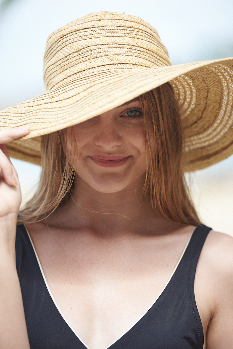 Balistarz-model-India-Rose-portrait-shoot-holding-a-sun-hat-in-a-swimsuit-by-Angela-Paterman