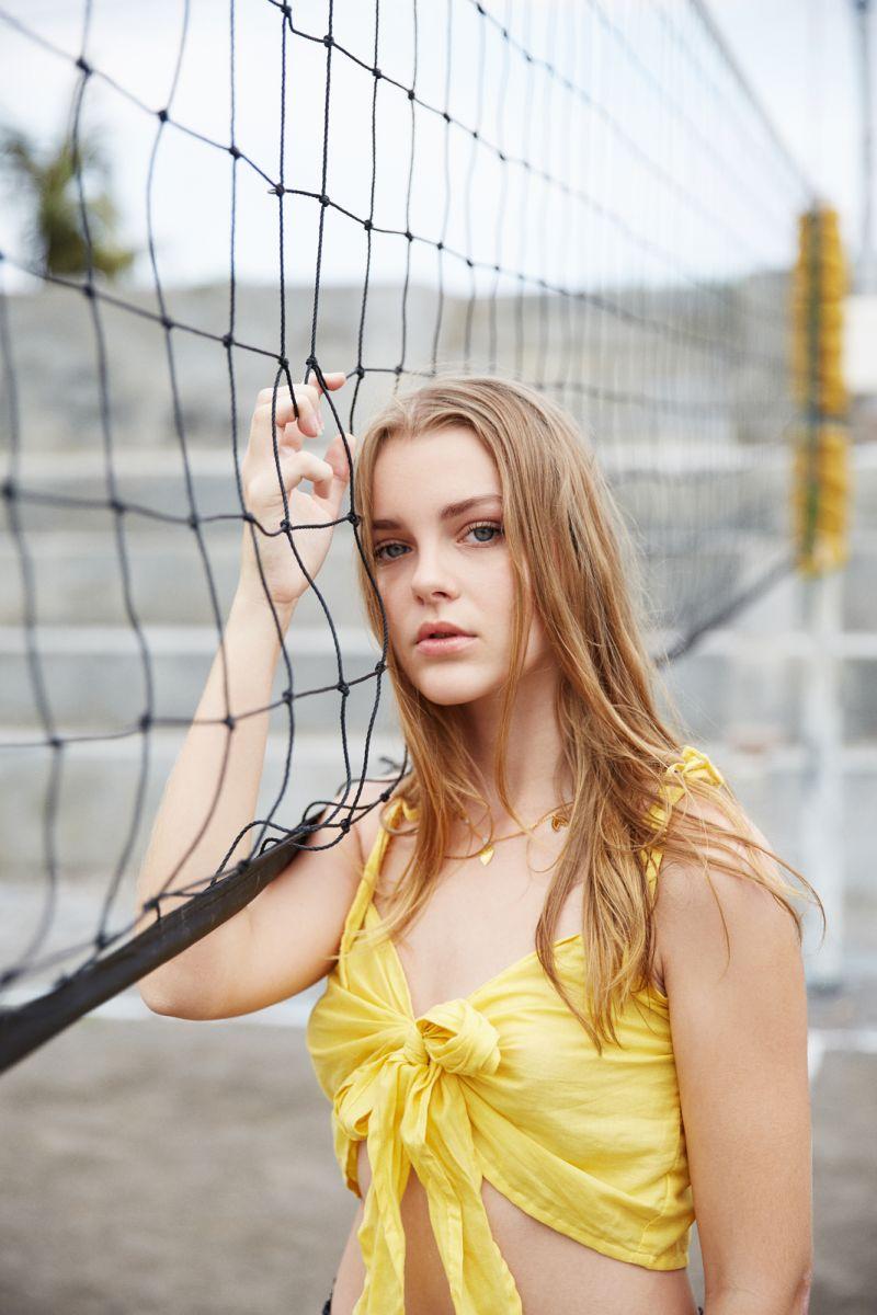 Balistarz-model-India-Rose-profile-wearing-yellow-top-beautiful