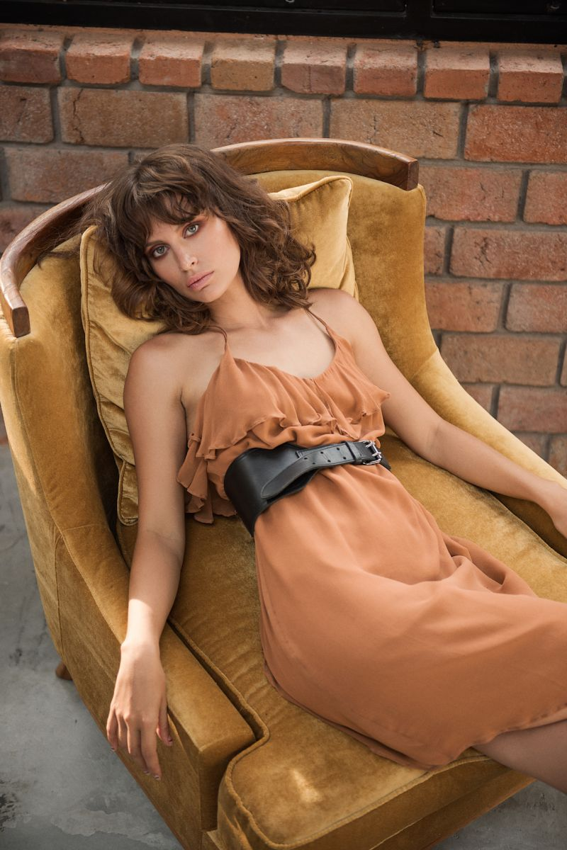 Balistarz-model-Irina-Kro-portrait-shoot-for-Uma-Leopold-laying-on-a-sofa-chair-in-a-dress