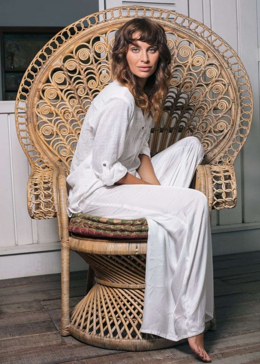 Balistarz-model-Irina-Kro-portrait-shoot-in-a-casual-white-outfit-with-a-peacock-armchair