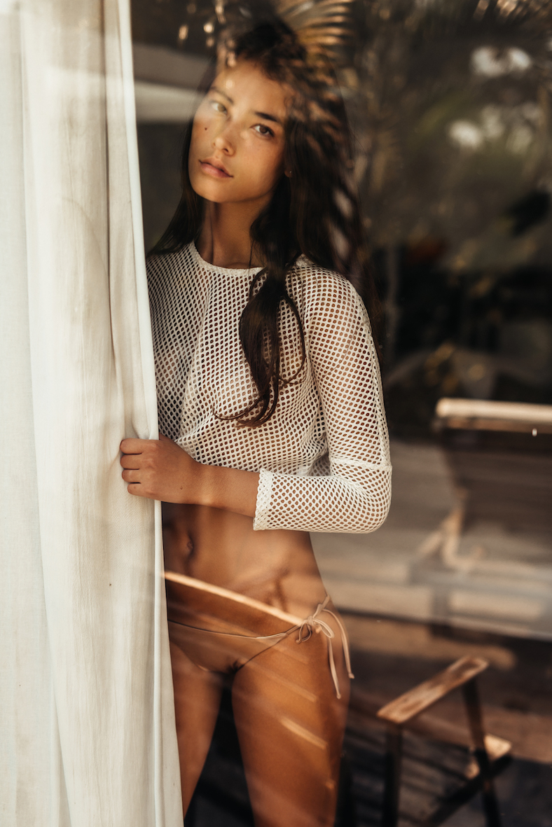 Balistarz-model-Izra-Van-Oorschot-looking-through-her-window-in-her-bikini-and-white-top