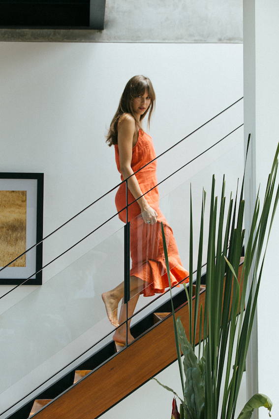 Balistarz-model-Jacqueline-Graba-portrait-shoot-in-a-orange-dress-going-up-stairs