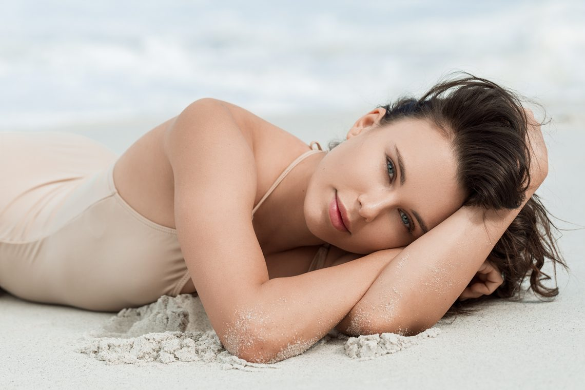 Balistarz-model-Jacqueline-Graba-portrait-shoot-for-Megan-Davies-Photography-in-a-swimsuit-laying-on-the-sand