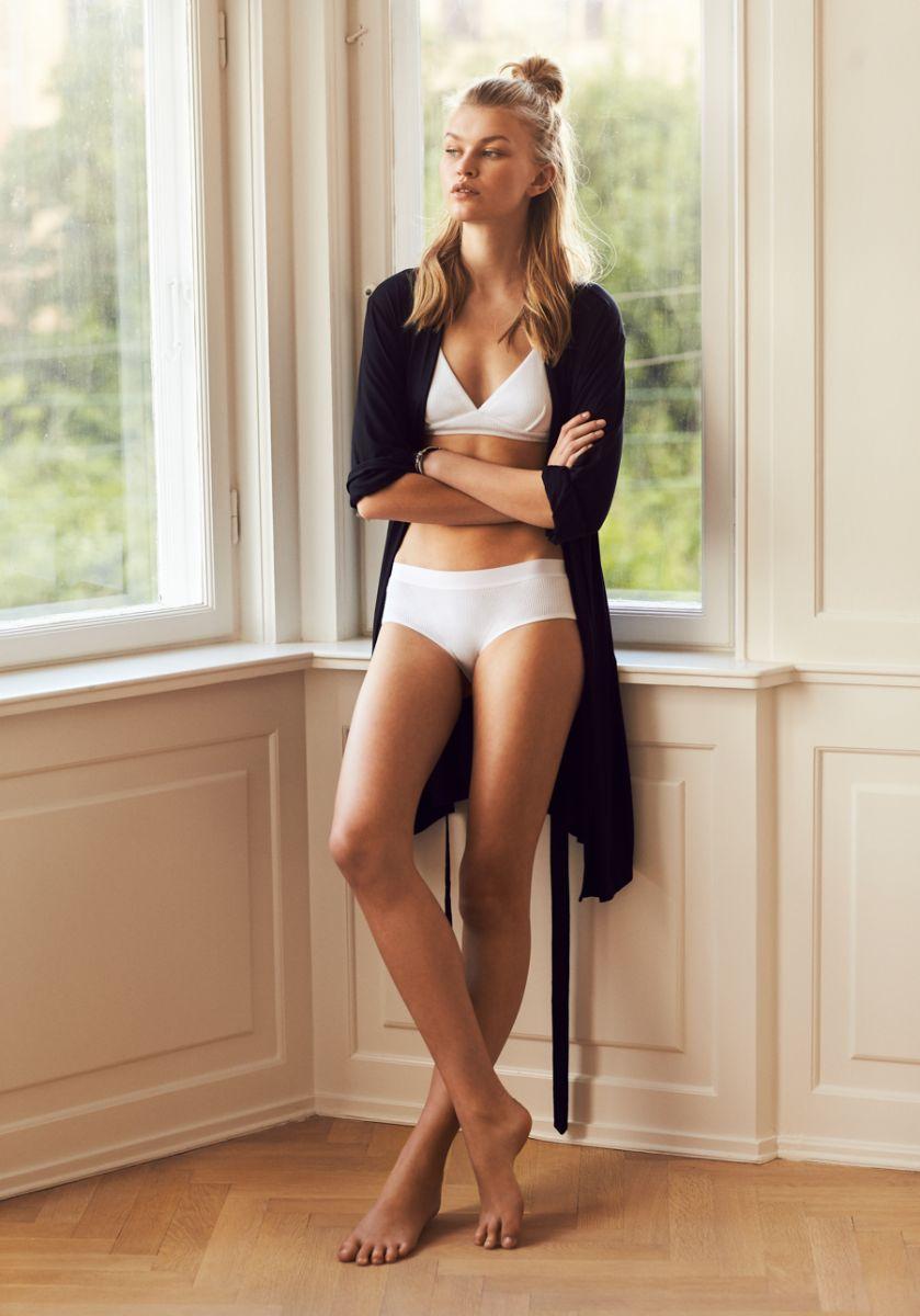 Balistarz-model-Josefine-Justesen-portrait-shoot-with-a-black-long-sleeve-jacket-looking-out-the-window