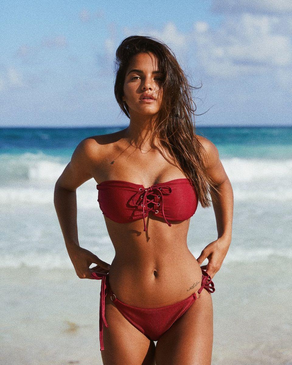 Balistarz-model-Julia-Muniz-portrait-beach-shoot-in-a-red-bikini-with-the-beautiful-sea-in-the-background