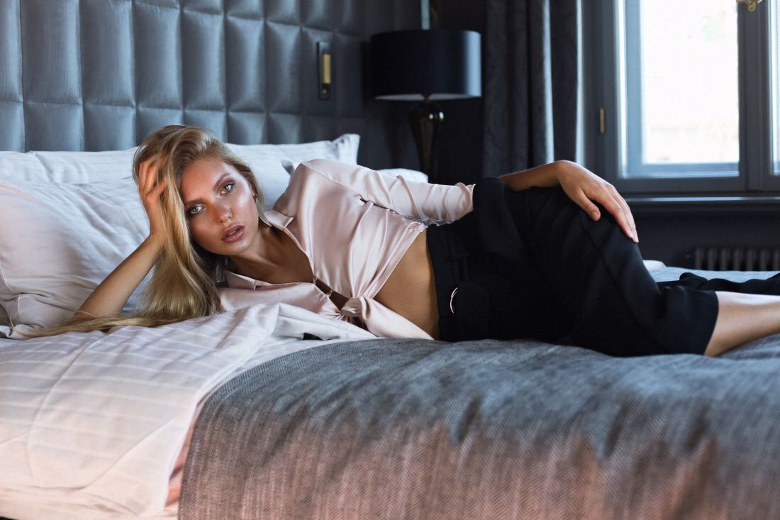 Balistarz-model-Laura-Ziedone-poses-on-hotel-bed