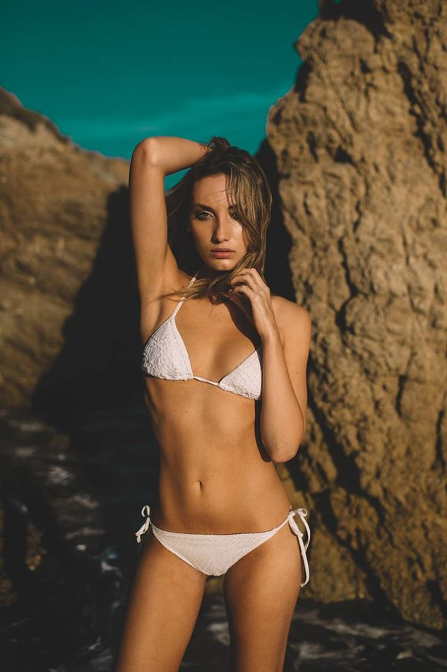 Balistarz-model-Lizette-Croes-in-a-white-bikini-looking-seductive-and-sexy-on-a-beach