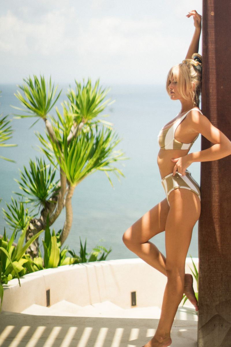 Balistarz-model-Louise-Mikkelsen-leans-agains-the-wooden-pillar-wearing-cute-bikini
