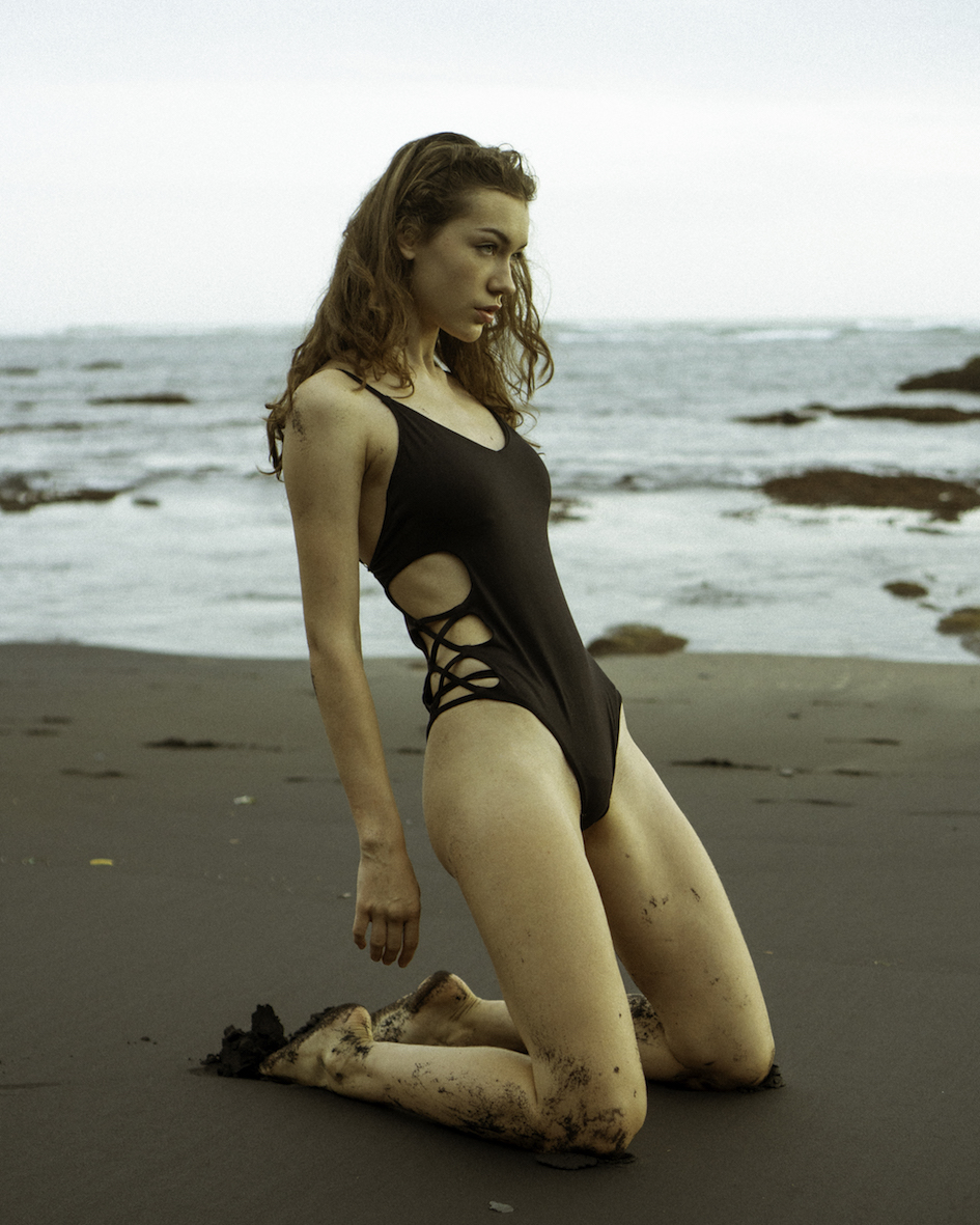 Balistarz-model-Macili-Massine-portrait-beach-shoot-with-a-black-swimsuit-and-sand
