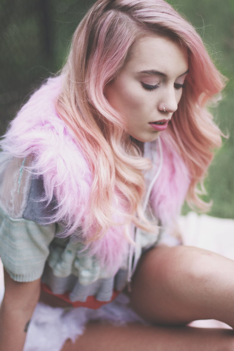 Balistarz-model-Maddie-Quinn-profile-shot-sitting-while-her-beautiful-hair-flows-like-cotton-candy