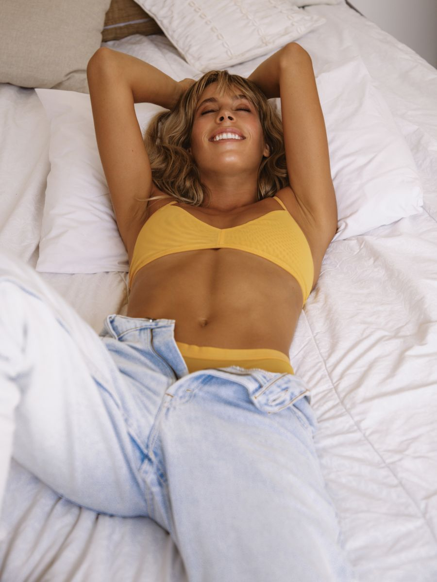 Balistarz-model-Madeline-Relph-laying-on-her-bed-and-feeling-gratefull