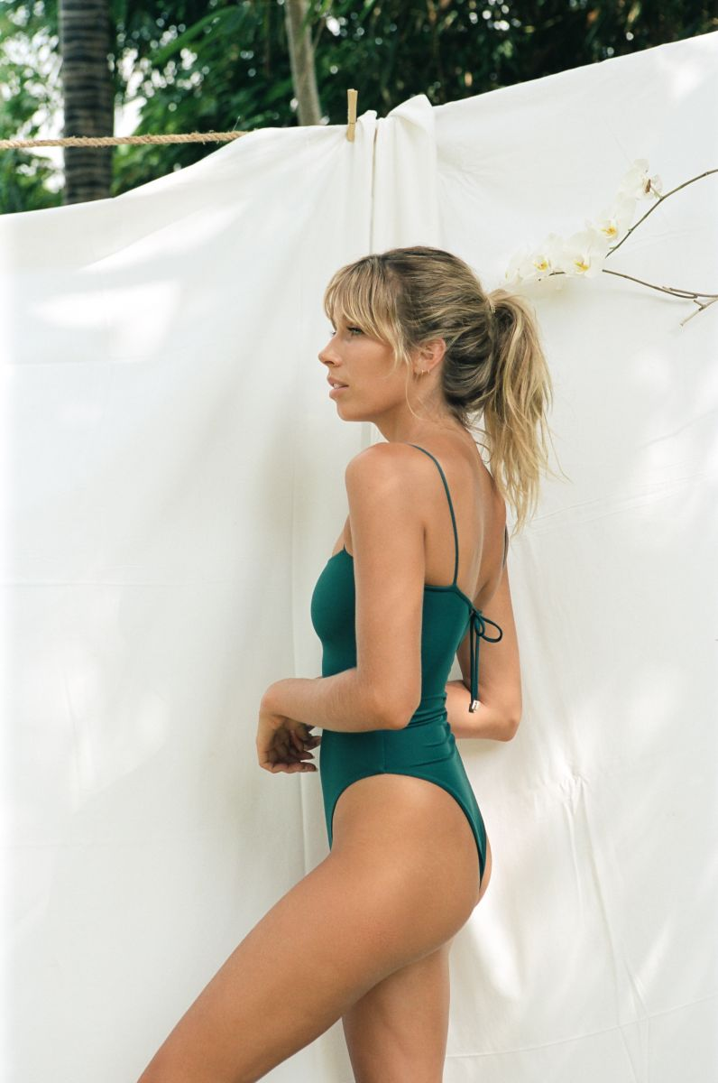 Balistarz-model-Madeline-Relph-swim-wear-shot-green-swim-suit-in-front-of-white-background