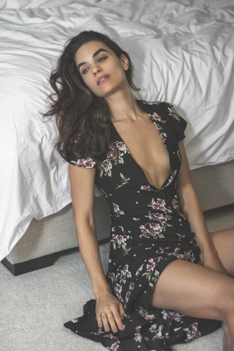 Balistarz-model-Michelle-D'agostino-profile-flower-dress-bed-side