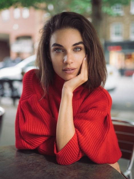 Balistarz-model-MIchelle-D'agostino-profile-shoot-in-red-sweater-staring-at-the-person