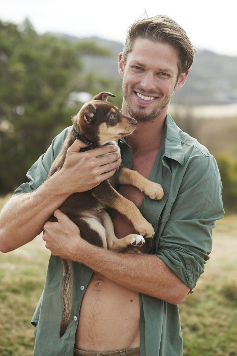 Balistarz-model-Mitch-Walker-casual-fashion-shot-for-irving-and-powell-clothing-brand-playing-with-cute-puppy