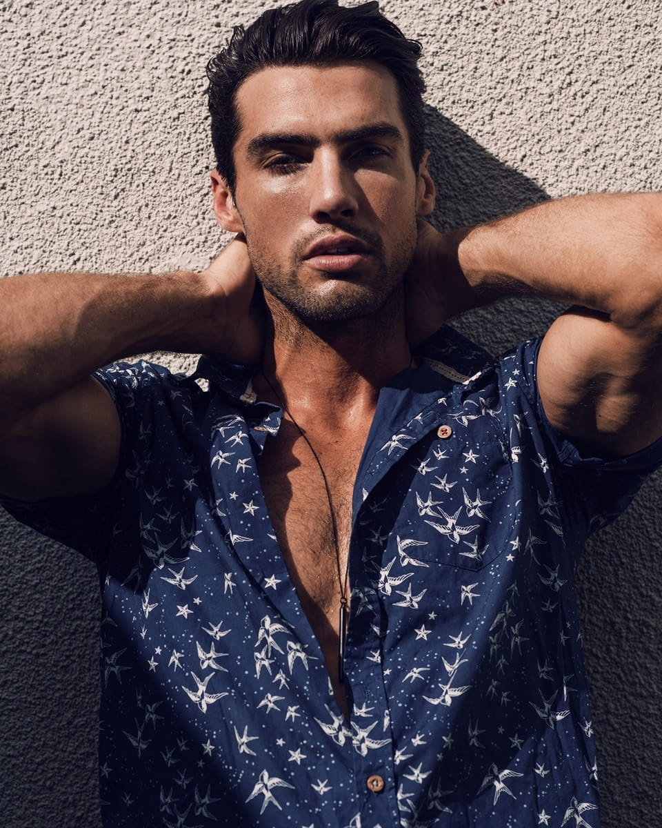 Balistarz-model-Mitchell-Wick-casual-portrait-shot-wearing-blue-unbuttoned-shirt