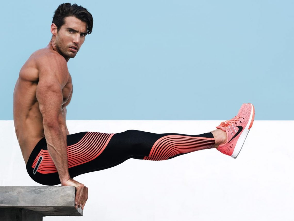 Balistarz-model-Mitchell-Wick-sport-style-doing-exercises-long-training-pants-and-pink-nike-shoes