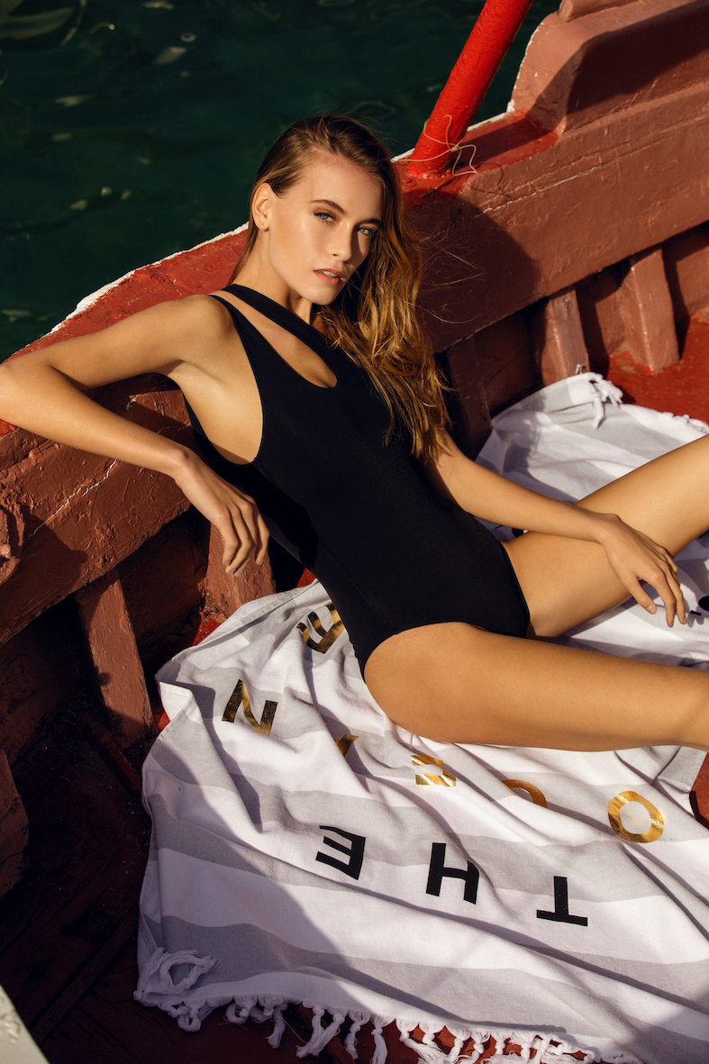 Balistarz-model-Nastya-Beresneva-in-a-boat-on-the-ocean-while-she-lays-down-in-her-black-swimwear