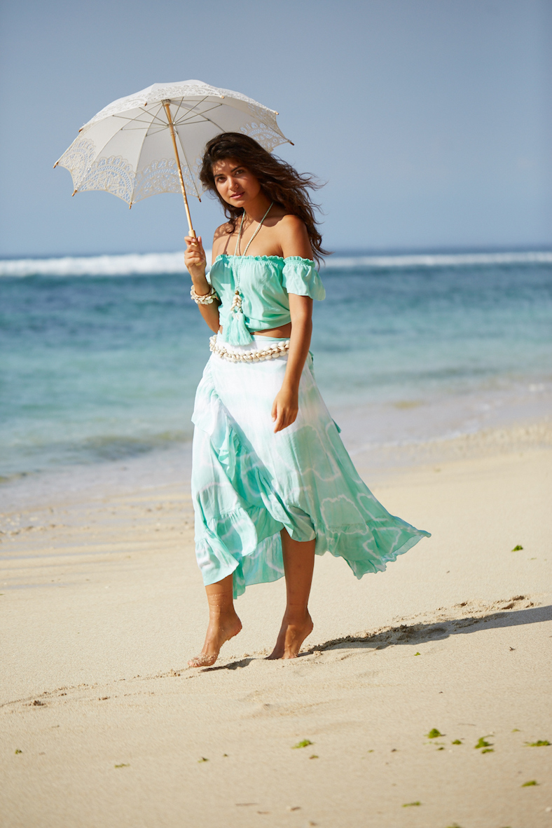 Balistarz-model-Nena-France-walking-at-the-beach-under-the-umbrella-wearing-casual-pastel-color-dress-by-hot-lava