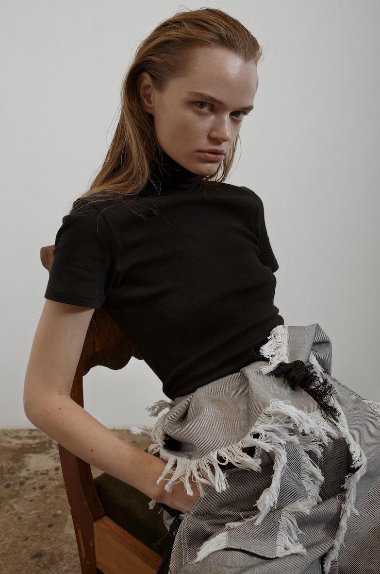 Balistarz-model-Olga-Zinoyveva-portrait-shoot-in-casual-clothing-sitting-on-a-chair