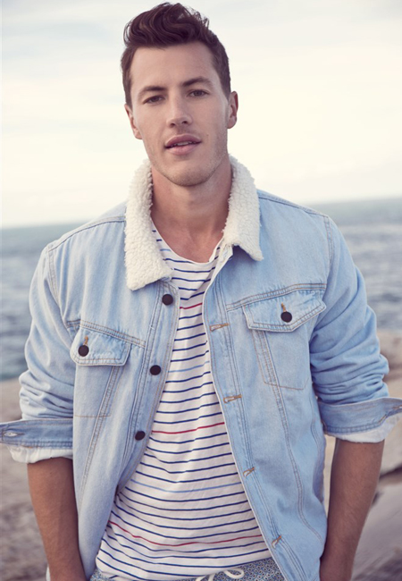 Balistarz-model-Ollie-Bracewell-casual-portrait-taken-near-the-beach-wearing-shirts-and-blue-jeans-jacket