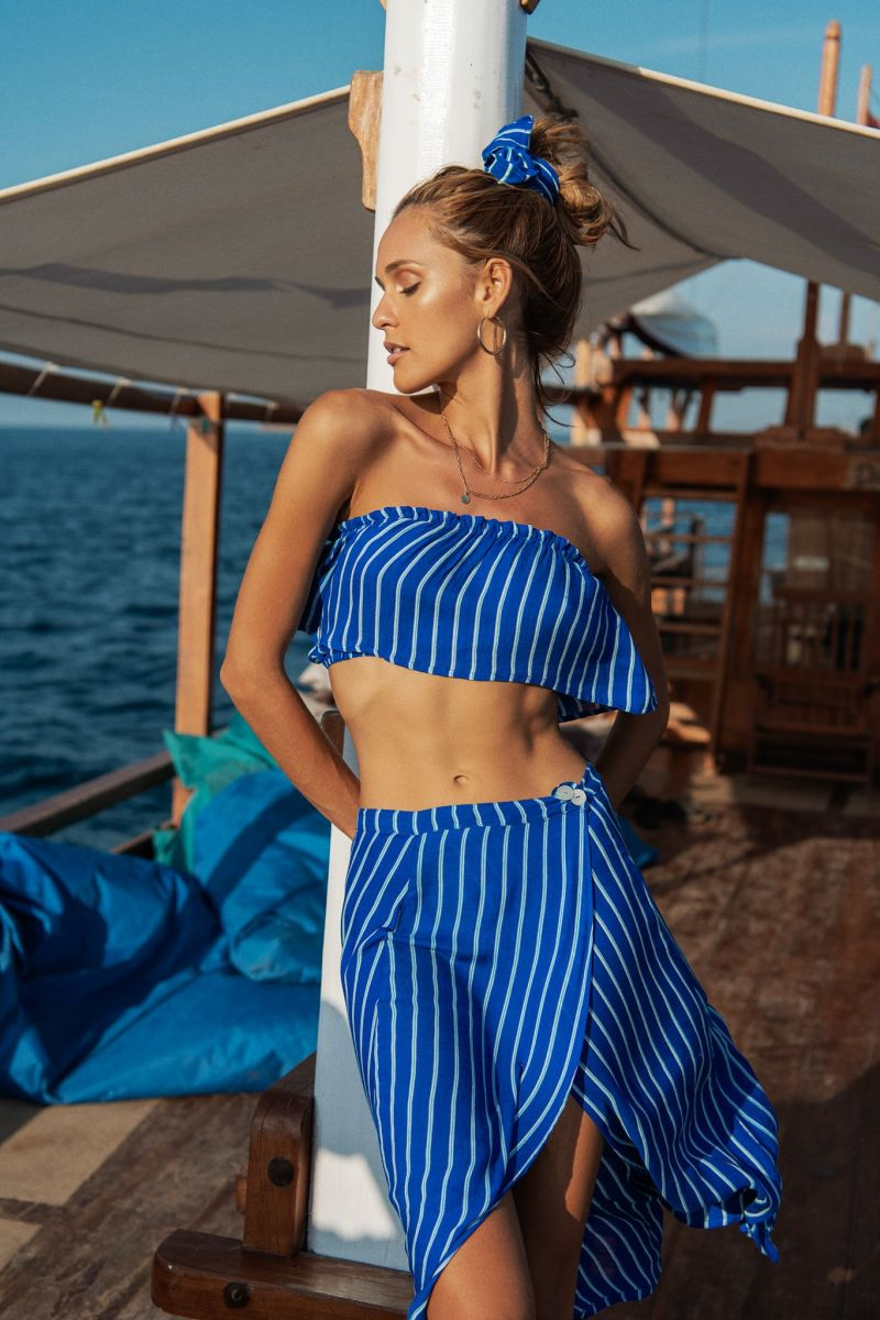 Balistarz-model-Paula-Salort-portrait-shoot-for-Beach-gold-in-blue-clothing-on-a-boat