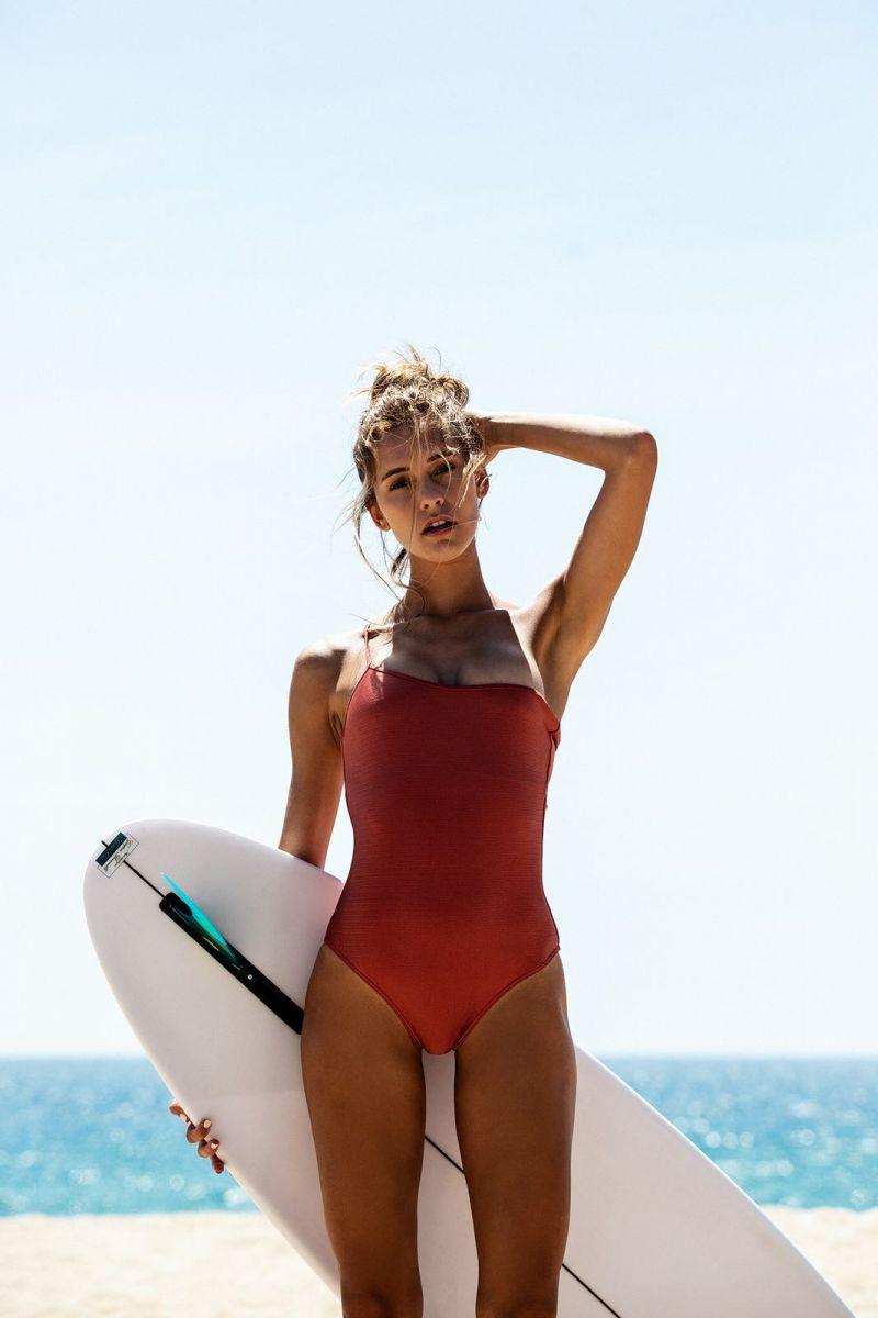 Balistarz-model-Paula-Salort-beach-shot-with-red-swim-suit-and-surf-board