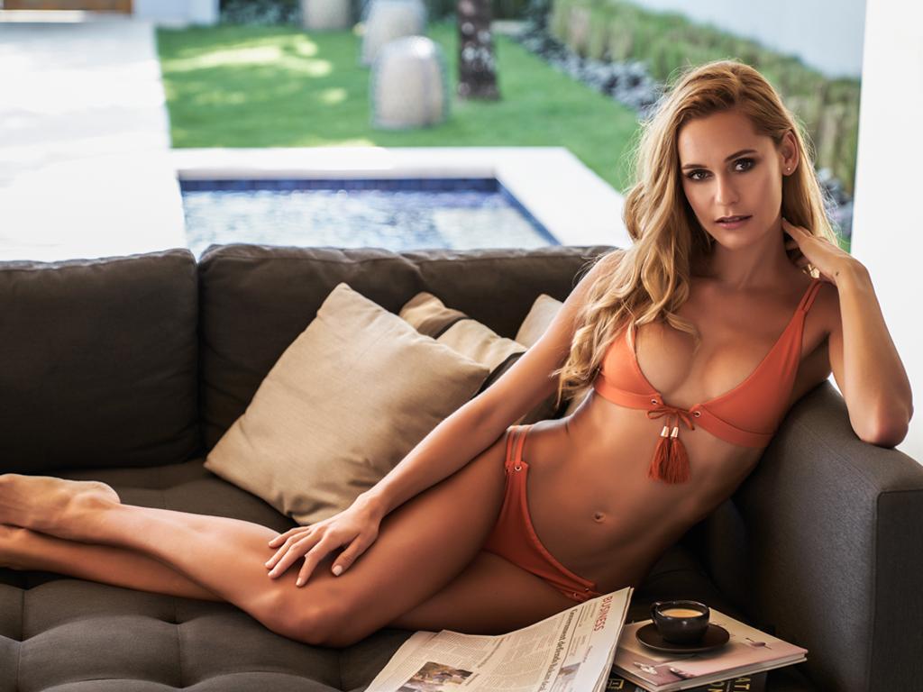 Balistarz-model-Paula-Salort-portrait-shoot-on-a-couch-in-a-orange-bikini