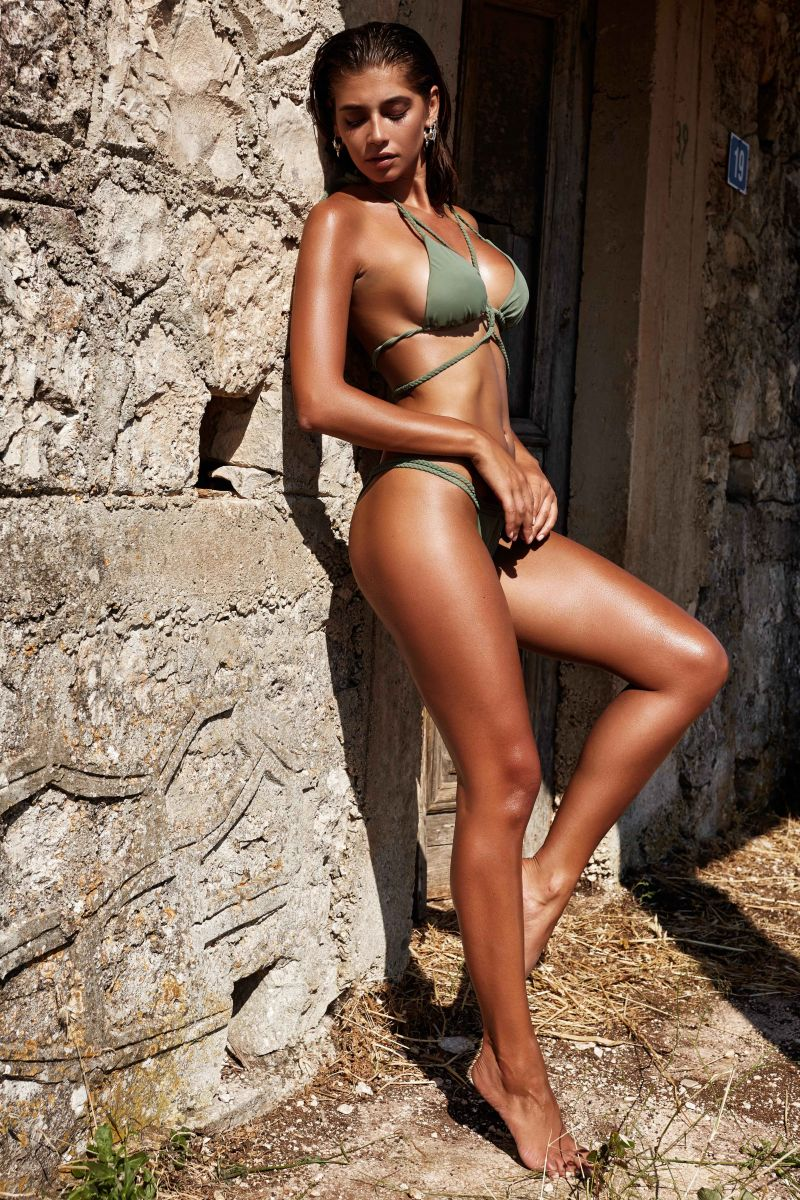 Balistarz-model-Raluca-Cojocaru-bikini-shot-on-solid-stone-wall
