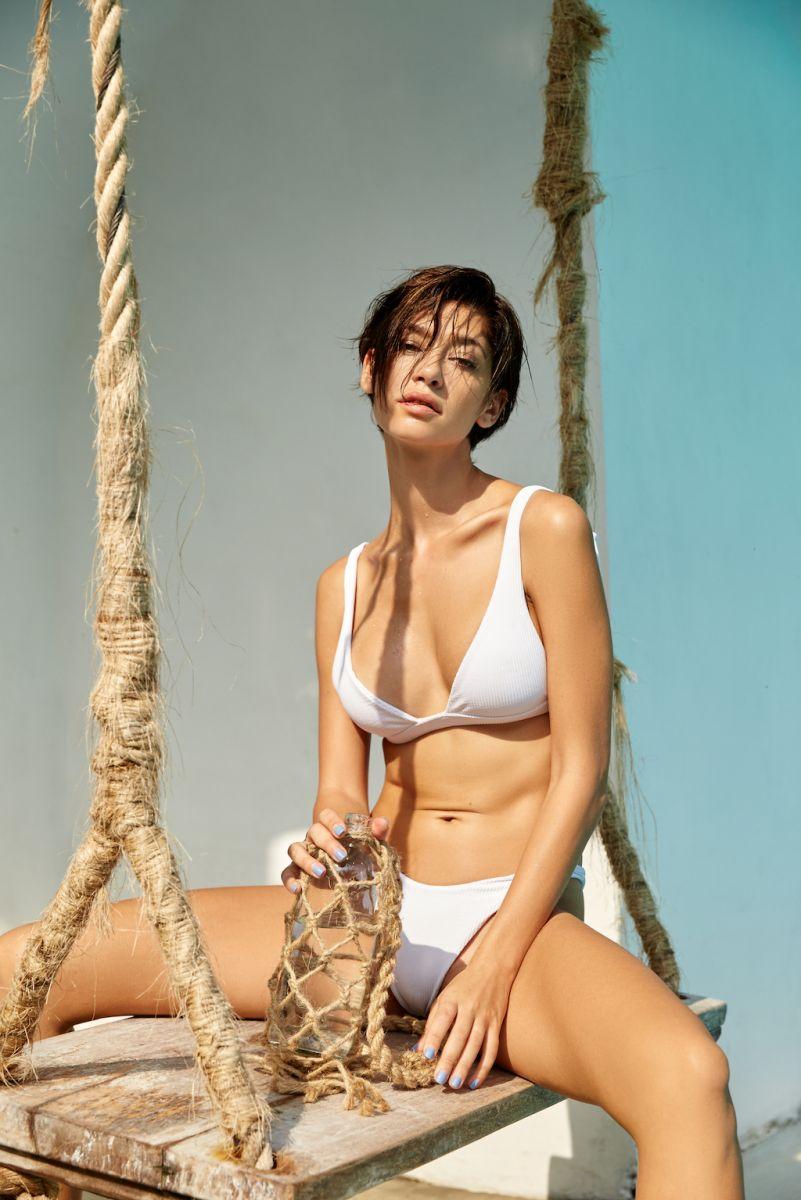 Balistarz-model-Raluca-Cojocaru-sitting-on-swing-wearing-white-bikini