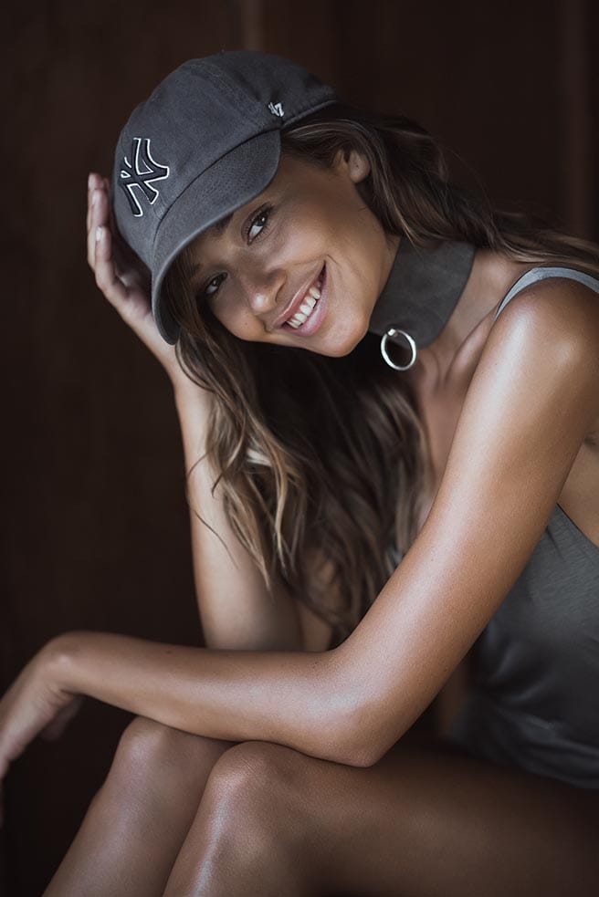 Balistarz-model-Raluca-Cojocaru-smiling-portrait-put-on-new-york-hat