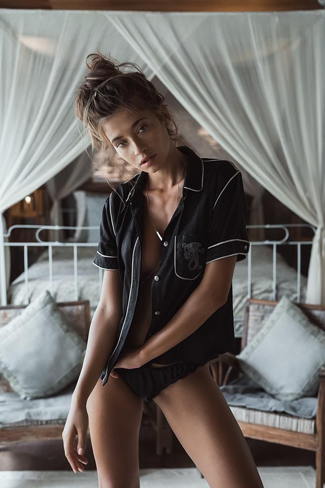 Balistarz-model-Raluca-Cojocaru-shot-on-bed-putting-on-black-lingerie