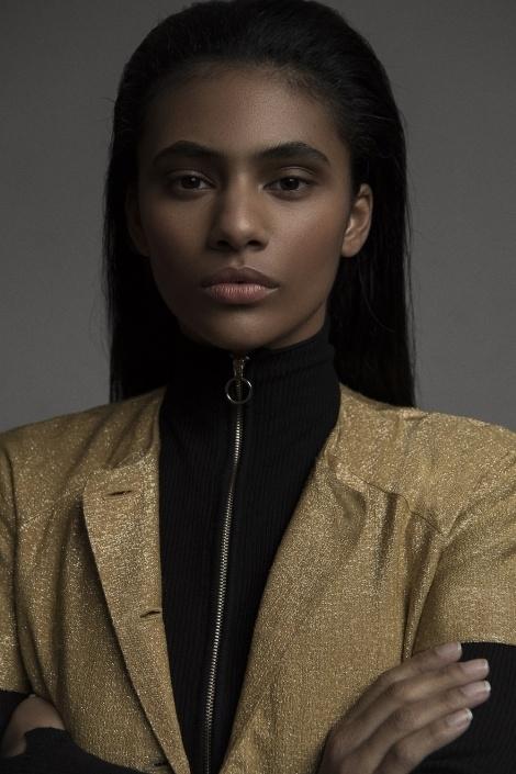 Balistarz-model-Rocky-Brower-studio-portrait-shot-in-black-and-gold-dress