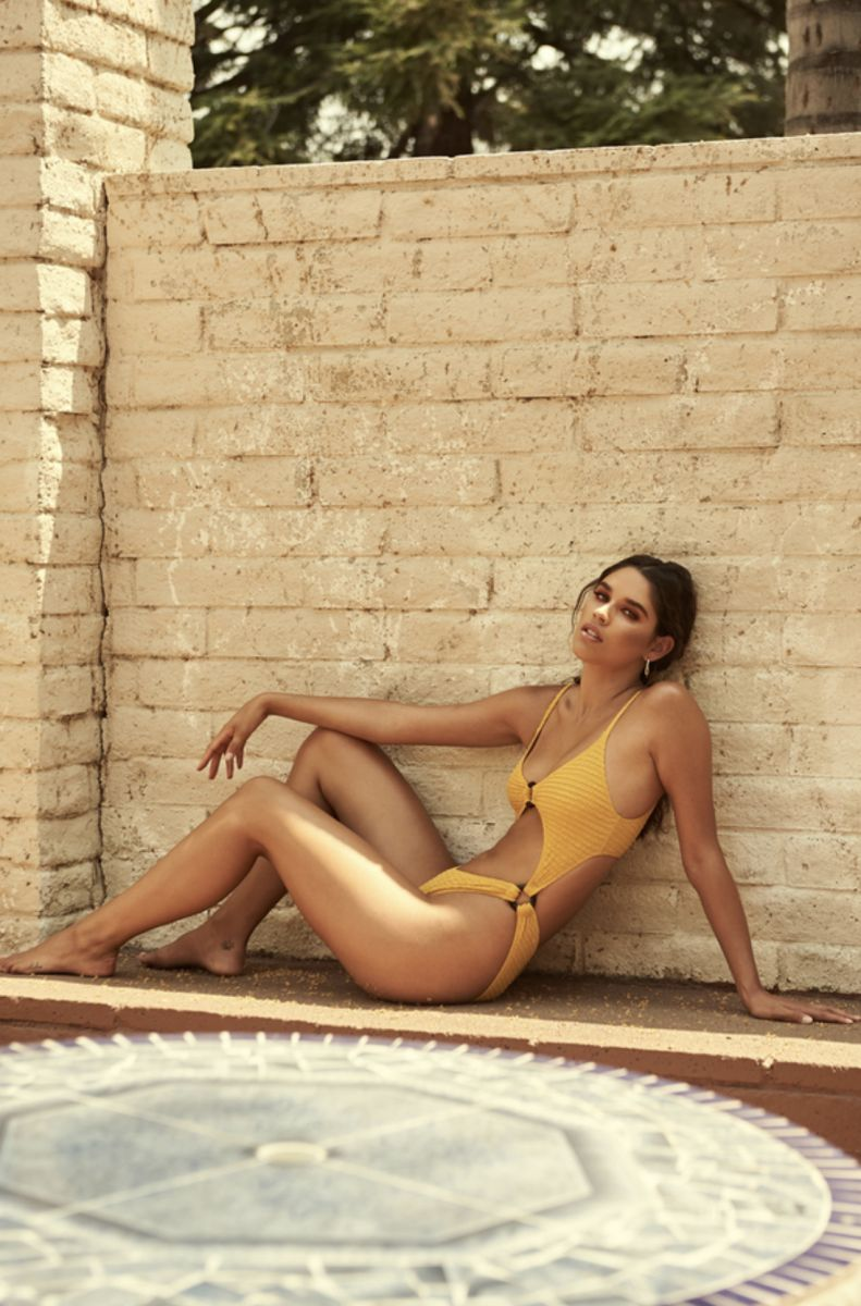 Balistarz-model-Samantha-Garza-portrait-shoot-sitting-in-a-yellow-swimsuit-with-accessories