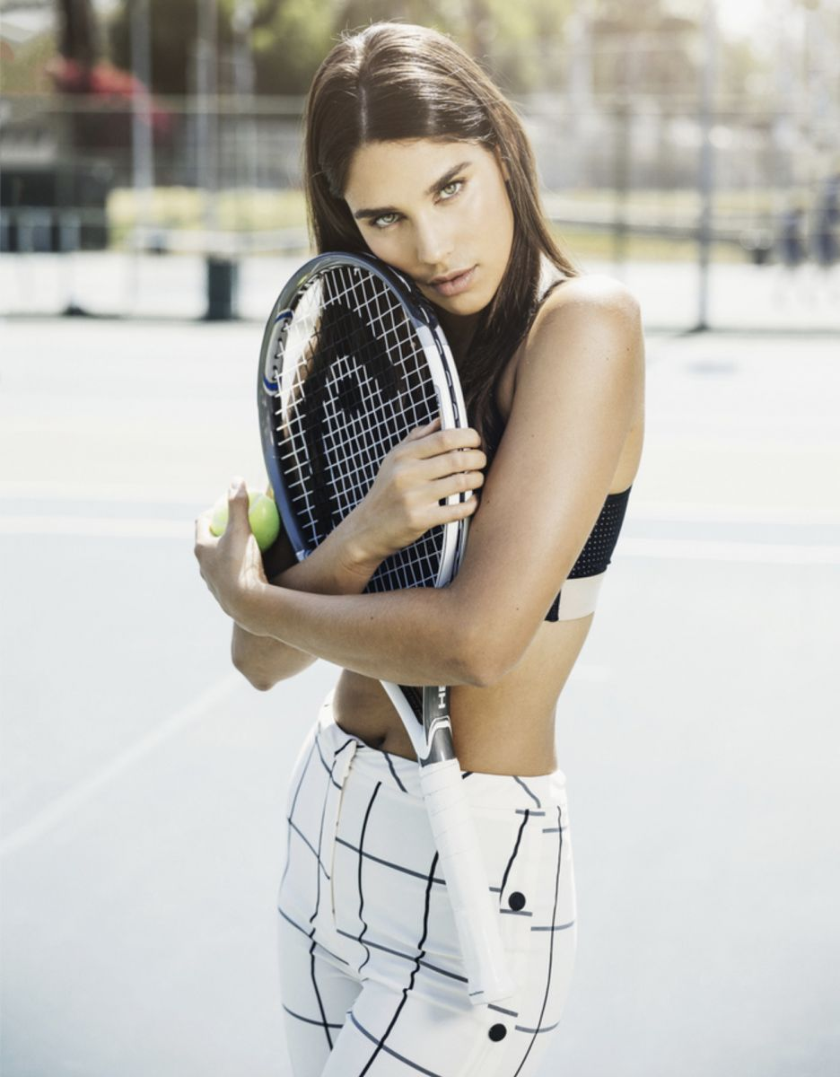 Balistarz-model-Samantha-Garza-portrait-sport-shoot-hugging-a-tennis-racket-and-holding-a-ball-in-black-and-white-clothing